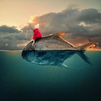 enfant sur poisson
